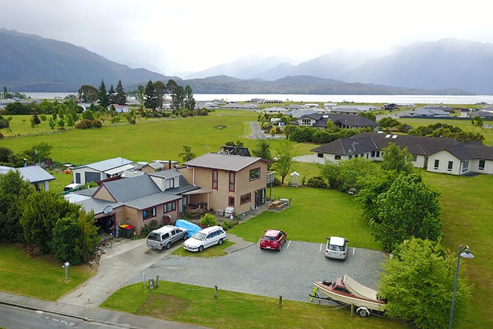 An aerial view of Rosie's Backpackers with Lake Te Anau