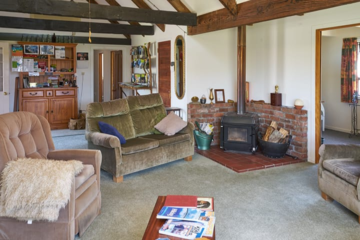 Living room and cosy fireplace at Rosie's Backpacker Te Anau home stay